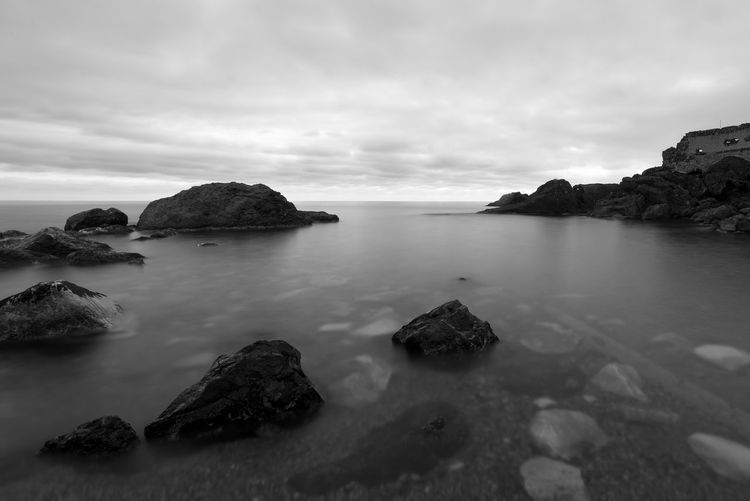 b&w in Framura Water Rock Sky Beauty In Nature Rock - Object Cloud - Sky Sea Solid Scenics - Nature Tranquility Idyllic No People Nature Day Rock Formation Non-urban Scene Horizon Over Water Outdoors Stack Rock Land Blackandwhite Bw_collection Framura Long Exposure Italy