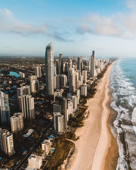 A drone shot of the incredible, beach front skyscrapers at Surfers Paradise Australian Beaches Australia Golden Hour Coast Coastline Buildings & Sky Buildings Aerial Photography Drone  Dronephotography Gold Coast Surfers Paradise Building Exterior City Built Structure Architecture Sky Sea Beach Cityscape Nature Building Cloud - Sky Office Building Exterior Skyscraper Sand Land Day First Eyeem Photo My Best Photo