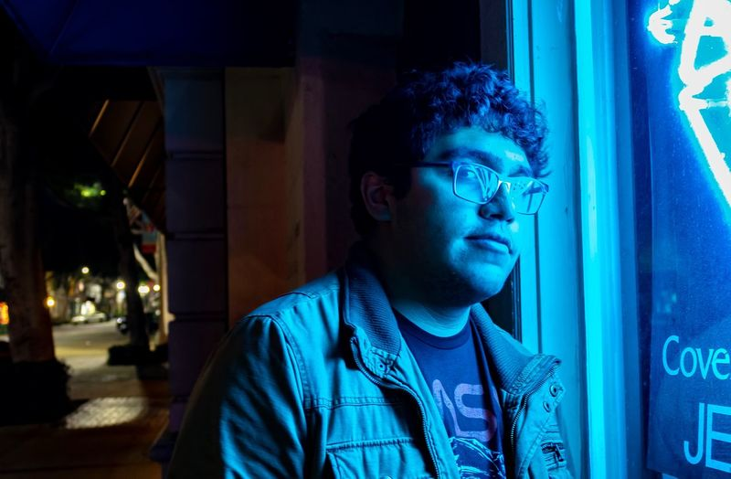 Blue boy One Person Night Real People Headshot Illuminated Blue Lifestyles Front View Young Adult Casual Clothing Leisure Activity Architecture Men Young Men Glasses Portrait Looking Looking Away Standing Contemplation Humanity Meets Technology The Portraitist - 2019 EyeEm Awards