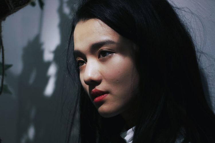 Portrait of beautiful woman looking away