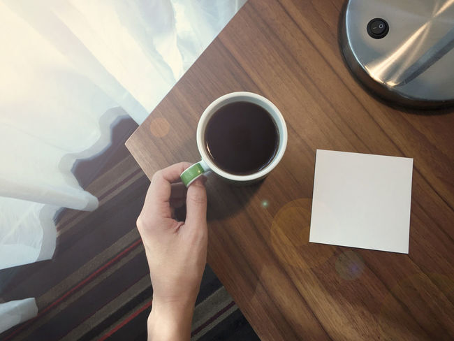 Coffee Coffee - Drink Communication Day Drink High Angle View Indoors  Light And Shadow Message Mobile Phone Morning Morning Light NotePad Notes Table Technology Wood - Material Workspace