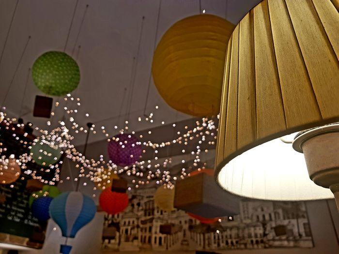 Low angle view of lanterns hanging at night