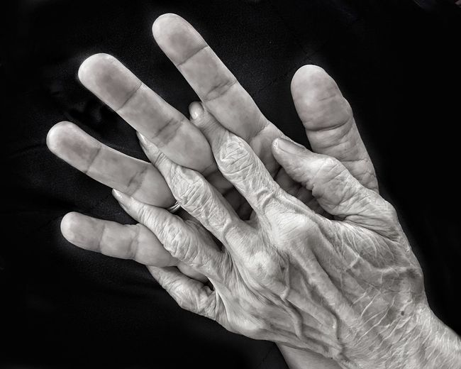Close-up of hands over black background