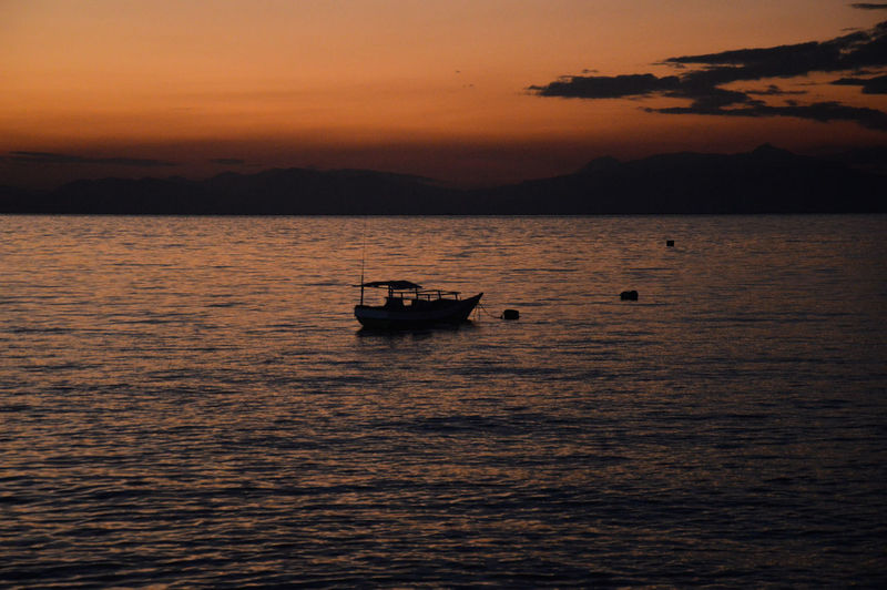 Sunset Water Nautical Vessel Transportation Sky Cloud - Sky Sea Silhouette No People Nature Orange Color Beauty In Nature Waterfront Scenics - Nature Mountain Idyllic Tranquility Mode Of Transportation Tranquil Scene Outdoors