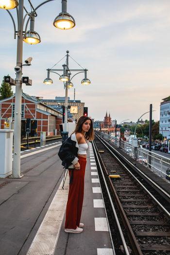 Full length of woman on railroad station platform