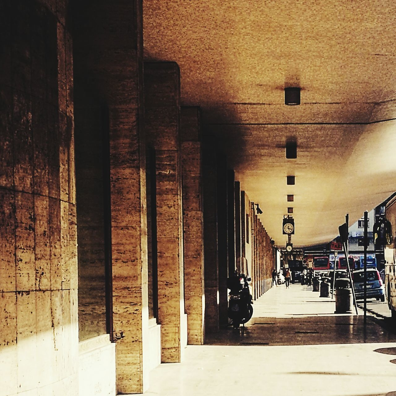 in a row, architectural column, architecture, indoors, the way forward, built structure, pillar, illuminated, no people, day