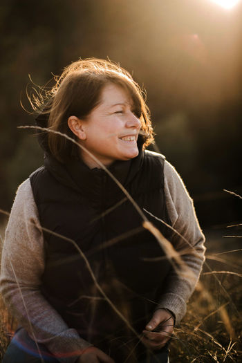 Beautiful portrait of a  stylish woman on a sunny day in autumn