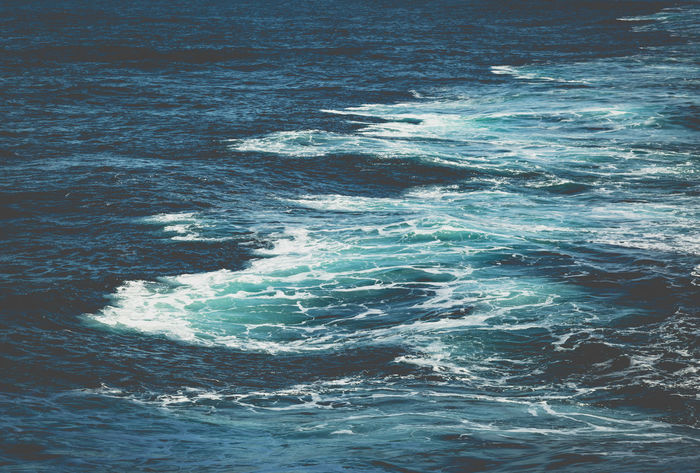 Waves behind boat while adventure holiday cruise through ocean in bright sun light Backgrounds Beauty In Nature Behind Boat Creativity Cross Section Cruise Deep Depths Exploring Foam Full Frame Composition Holiday Memories Nostalgia Ocean Paradise Sea Splash Surfing Text Space Tourism Destination Traveling Voyage Water Wave