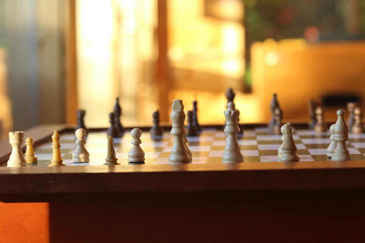 Close-up of chess board on table at home