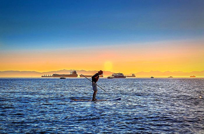 Wakeboard man in the ocean. Wakeboarding Wakeboard Ocean Seaside Sea Sporting Balance Sunset Canada Vancouver