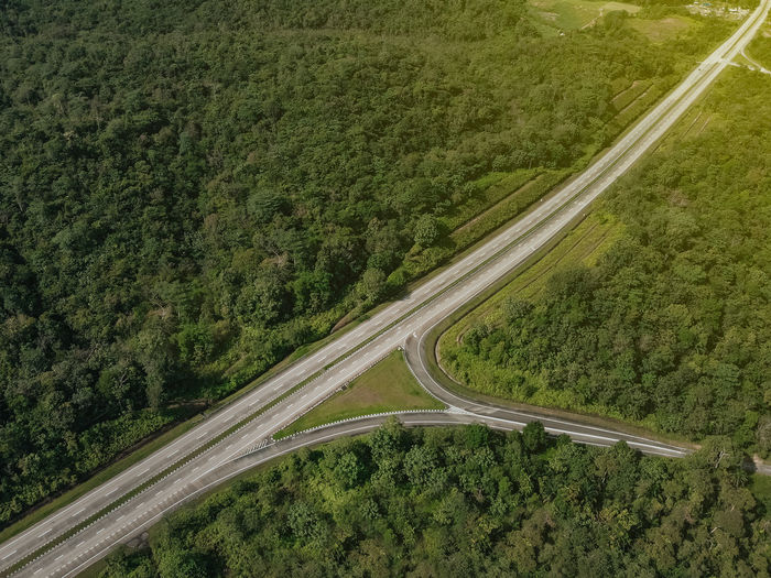 A highway that connected South and North of Peninsular Malaysia. Known as PLUS Highway. An arial view via drone on a sunset scenery with a copy space Road Transportation High Angle View No People Landscape Green Color Plant Highway Environment Day Scenics - Nature Nature Beauty In Nature Tree Land Mode Of Transportation Aerial View Non-urban Scene Tranquility Tranquil Scene Outdoors Multiple Lane Highway