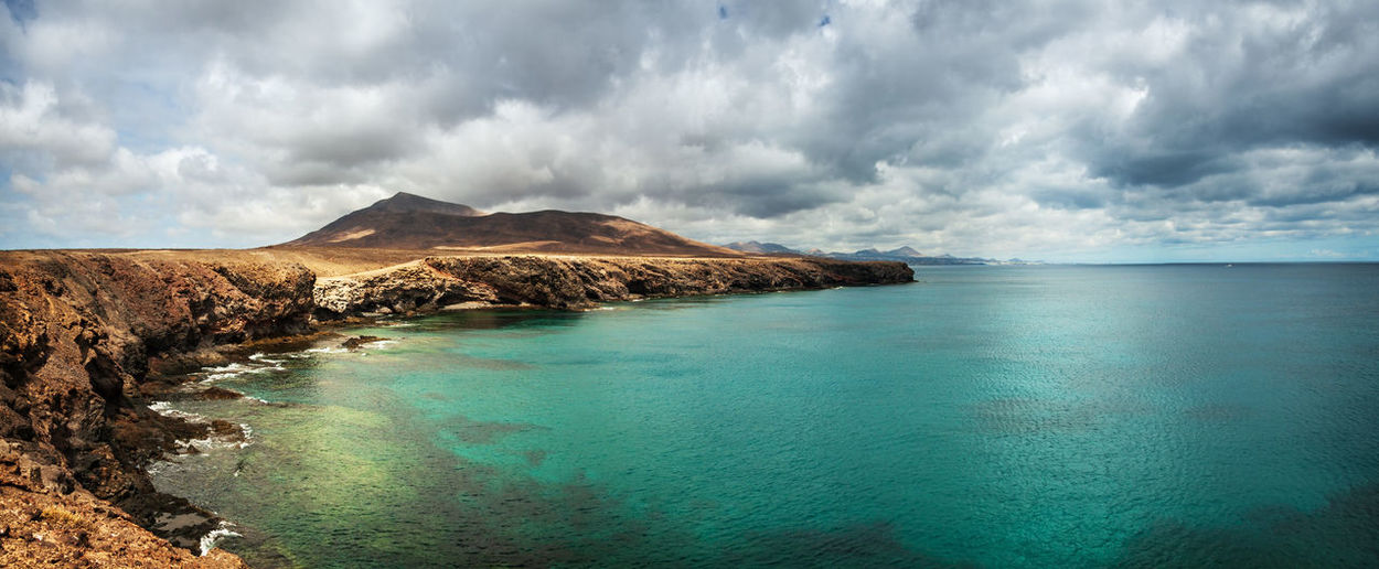 Seascape at Lanzarote, Spain Seascape Lanzarote Panoramic Coastline Cloud - Sky Scenics - Nature Water Sky Beauty In Nature Tranquil Scene Sea Tranquility Non-urban Scene Mountain Idyllic Nature Day Land No People Beach Remote Environment Horizon Outdoors Horizon Over Water Turquoise Colored Bay Spanje