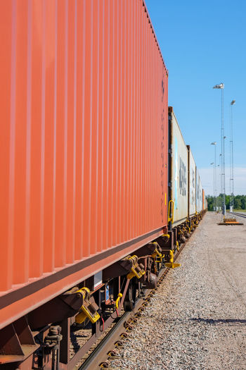 Container on a railway car Container Containers Railway Railway Track Railway Car Transportation Rail Transportation Train Train - Vehicle Freight Transportation Freight Train No People Mode Of Transportation Railroad Track Cargo Container Wagon  Yard Cargo Industrial Goods Logistic Logistics Terminal Export Import