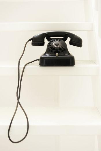 Old telephone on white stairs Telephone Phone Old Oldfashioned Retro Dialphones Bakelite Telefon Vintage Black White