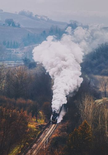 Smoke - Physical Structure Environment Environmental Issues Tree Nature Plant Emitting No People Day Rail Transportation Factory Smoke Stack Industry Land Smoke Outdoors Building Exterior Track Fumes Langhe Landscape EyeEmNewHere Piedmont Italy Steam Train Steam Locomotive