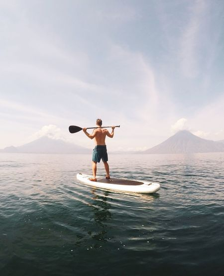 Between volcanoes Water Sea Sport Sky One Person Men Standing Beauty In Nature Cloud - Sky Nature Day Leisure Activity Lifestyles Adult Aquatic Sport Outdoors EyeEmNewHere