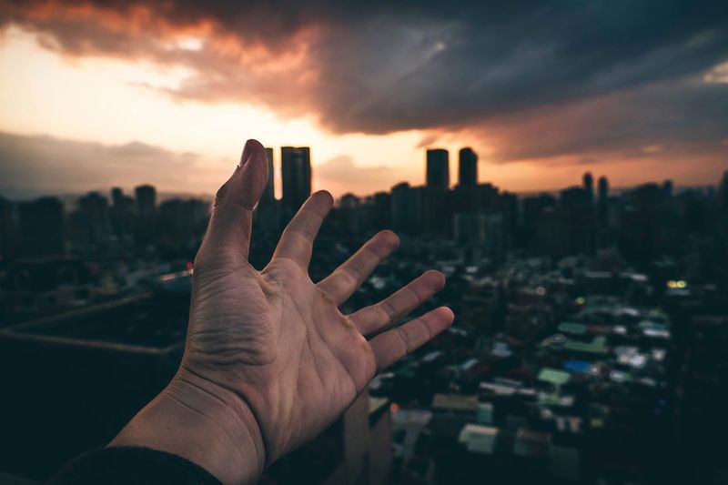 Sunset Human Hand Human Finger Human Body Part Real People Photography Themes One Person Communication Sunset Close-up Day Outdoors Sky Technology Architecture Nature Taiwan Roof