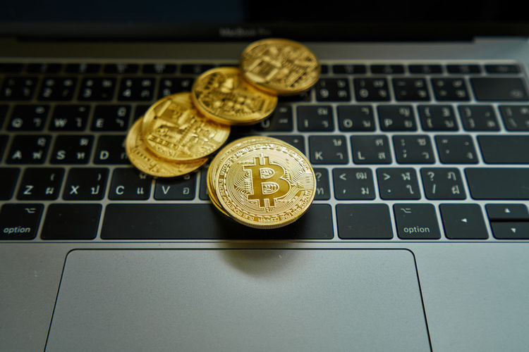 Close-up of coins on laptop keyboard
