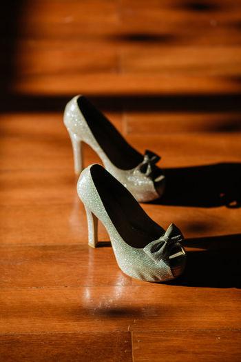 Close-up of high heels on wooden floor