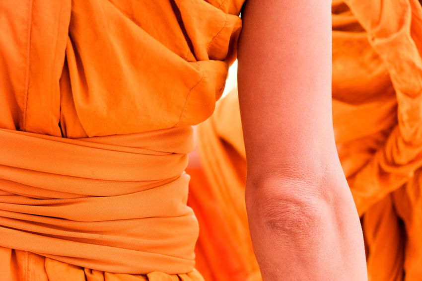 Yellow robe of Buddhist monks, Closeup on buddhist monk Buddhist Buddhist Temple In Thailand Religion And Tradition Religious Art Body Part Buddhist Culture Buddhist Monks Buddhist Temple Clothing Human Body Part Lifestyles Men Midsection Monk  Monks Orange Orange Color People Real People Religion Religion And Beliefs Religious  Robe Textile Yellow Robe