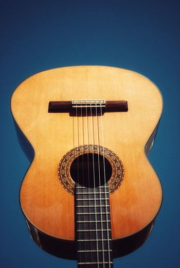 classical guitar against blue sky. Music Musical Instrument Musical Instrument String Arts Culture And Entertainment Guitar String Instrument No People Wood - Material Classical Music Close-up Fretboard Classical Guitar Sound