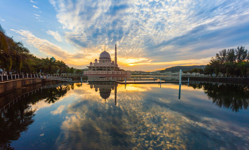 A beautiful morning with perfect reflection by the Putrajaya lake Architecture Built Structure Calm Cloud Cloud - Sky Malaysia Malaysia Truly Asia Mosque Mosques Nature No People Outdoors Putrajaya Reflection Scenics Sky Standing Water Sunrise Sunset Tourism Tranquil Scene Tranquility Travel Destinations Tree Water