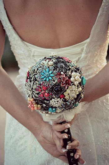 Midsection of woman holding artificial bouquet