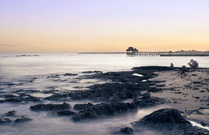 Beach Beauty In Nature Clear Sky Horizon Over Water Landscape Nature No People Outdoors Power In Nature Rock - Object Scenics Sea Sky Sunset Sunset_collection Travel Destinations Vacations Water Wave