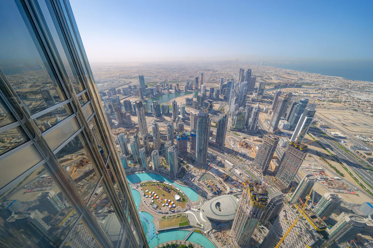 Cityscape seen from burj khalifa against clear sky