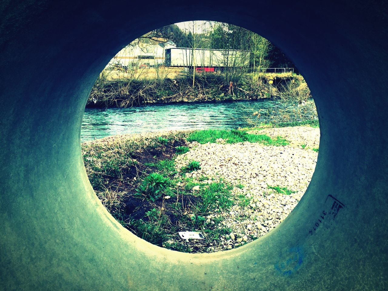 River Seen From Concrete Pipe