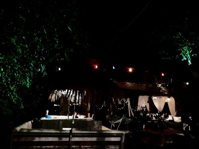 Illuminated restaurant against sky at night