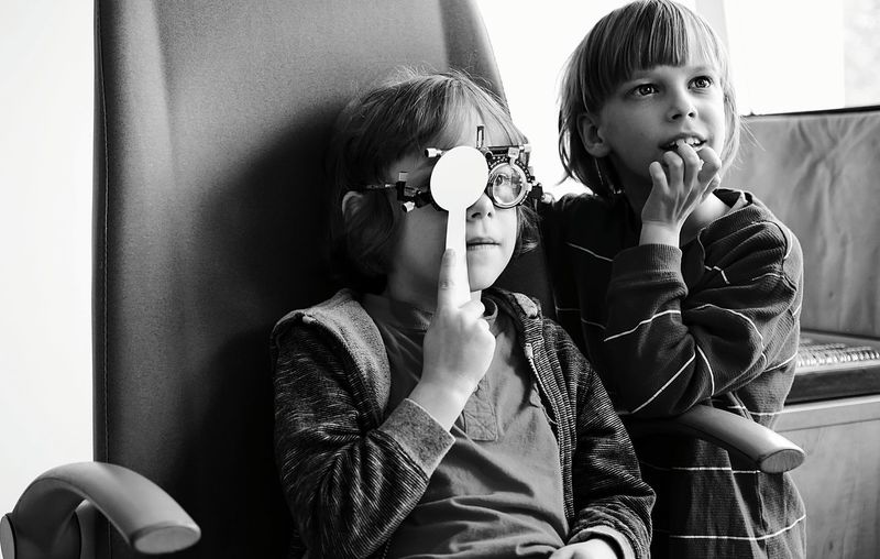 Boy wearing optometry with sister
