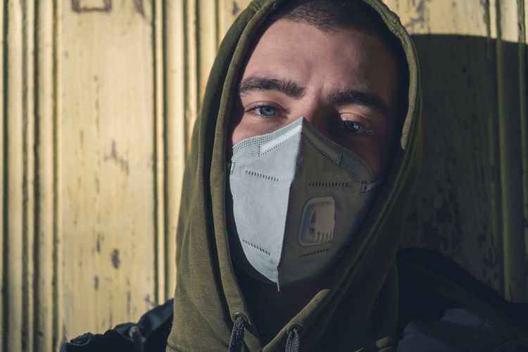 Portrait of man covering face