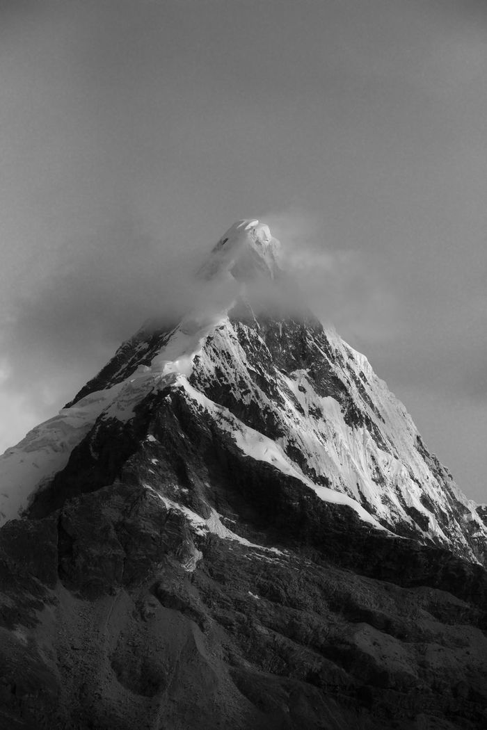 LOW ANGLE VIEW OF A MOUNTAIN AGAINST SKY