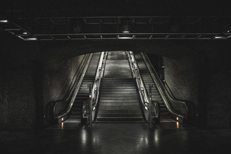 Staircase in illuminated tunnel