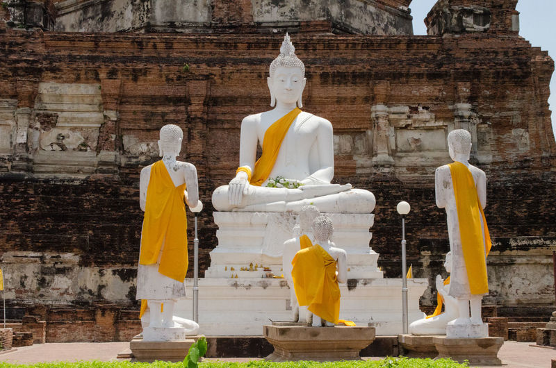 Buddha statues outside old ruin temple at ayuthaya province