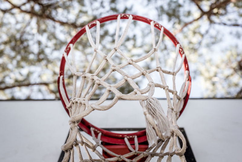 Basketball hoop low angle view Basketball Hoop Low Angle View Close-up Day Equipment Ground No People Nobody Outdoors Playground Selective Focus Sport Tree