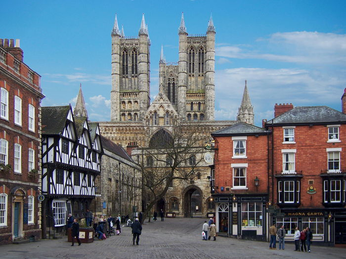 People on street against lincoln cathedral