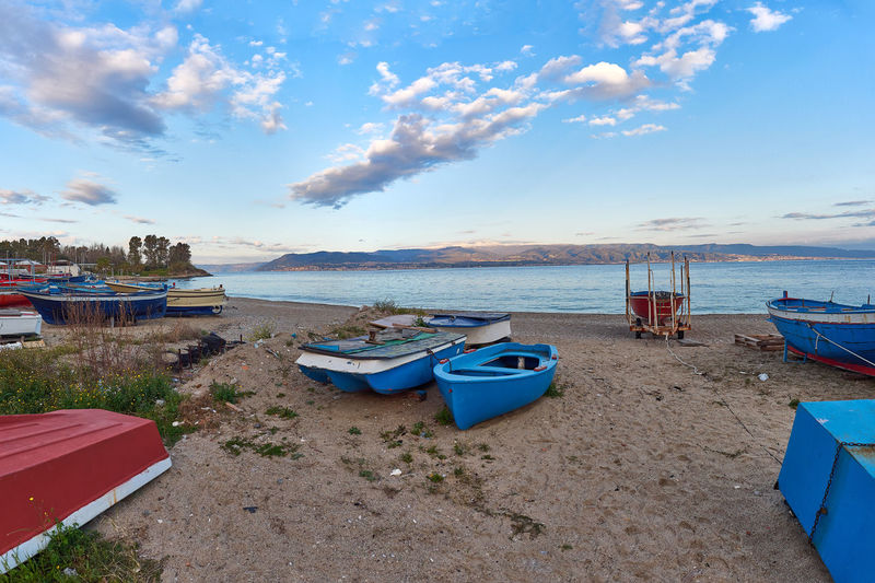 Landscape of Messina Sicily Beach Beachphotography Beauty In Nature Blue Boat Cloud - Sky Clouds Day Harbor Horizon Over Water Italy Mode Of Transport Moored Nature Nautical Vessel No People Outdoors Sand Scenics Sea Sky Tranquility Transportation Water