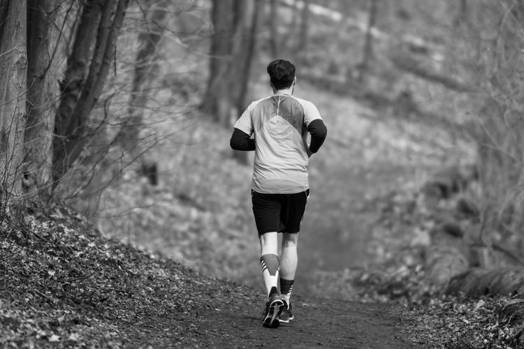Black And White Blackandwhite Day Full Length Healthy Lifestyle Jogging Lifestyles Men Nature One Person Outdoors Rear View Running Sports Clothing Tree