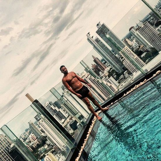 Feeling on top of the world Penthouse Pool Summer Sun Holiday Clouds Sky Water Swimwear Swimsuit Skyscrapers Citylife Lifestyle Friends Fun Beautiful City Dovolena Leto Chlap Muz Dark Male Addictedtoluxury