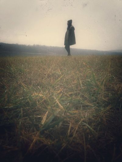 Full length of woman standing on grassy field
