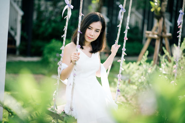 Women wear white dress. Adult Beautiful Woman Day Fashion Hair Hairstyle Holding Long Hair Nature One Person Outdoors Plant Real People Selective Focus Standing Three Quarter Length White Color Women Young Adult Young Women