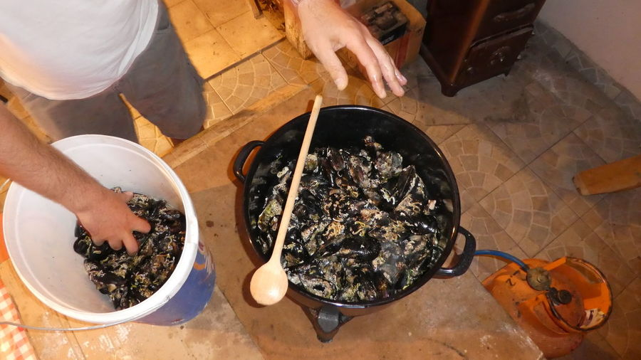 Cooking Croatia Cuisine EyeEm Best Shots Fresh Produce Hands Hands At Work Mediterranean  Seafood Close-up Day Eyeem Food  Food Freshness Healthy Eating High Angle View Hrvatska Lifestyles Mussels One Person People Ready-to-eat Real People Table Wooden Spoon