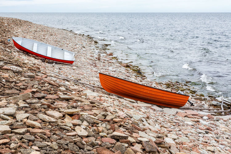 Boat moored on beach