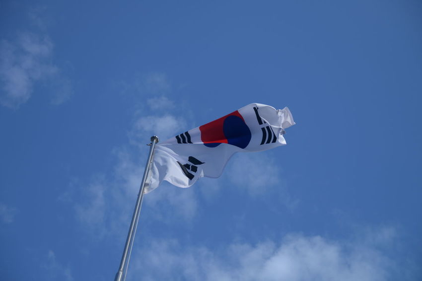 Sky Low Angle View Flag Patriotism Wind Nature Environment Blue Pole Day Cloud - Sky No People Red White Color Outdoors Waving Freedom Flying Copy Space Independence National Icon Korean Flag