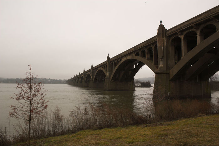 the old bridge over the susquehanna connecting columbia to wrightsville in pennsylvania Arch Architecture Bridge Bridge - Man Made Structure Built Structure City Day Nature No People Old Bridge Outdoors Reflection River Scenics Shore Sky Susquehanna River Travel Destinations Tree Water