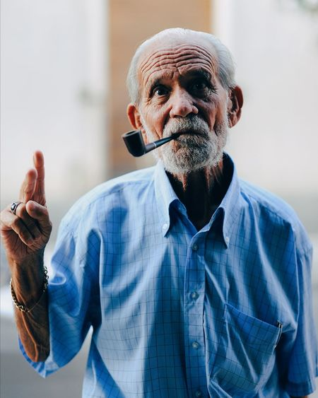EyeEm Selects man sicily old pipe peace Only Men One Person One Man Only Mature Adult Adult Front View Shaved Head Portrait People Mature Men Headshot Blue Day Looking At Camera Beard Outdoors Adult Senior Men Adults Only Men Human Body Part One Mature Man Only Indoors