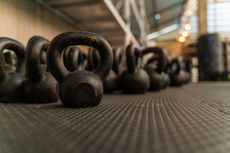 Close-Up Of Kettlebells On Floor At Gym