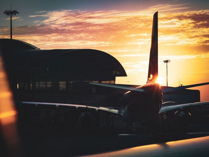 Touch Down City Sunset Silhouette Sky Architecture Built Structure Airport Runway Landing - Touching Down Jet Engine Commercial Airplane Passenger Boarding Bridge Aircraft Wing Airport Air Vehicle Airplane Airfield Private Airplane Engine Office Building EyeEmNewHere This Is Strength